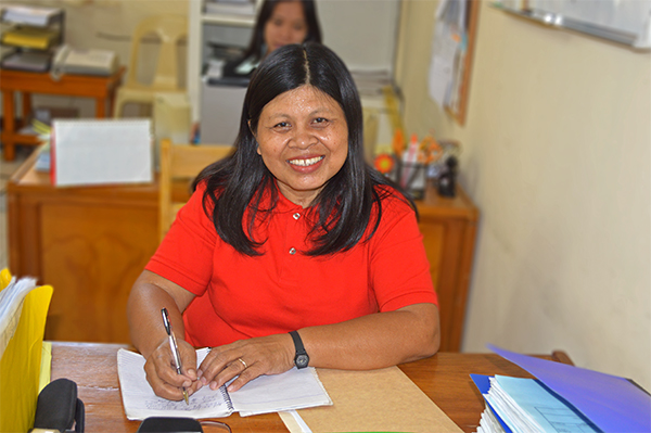 Elsie Bacayo at her desk