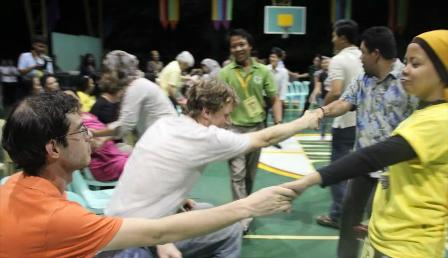 Peacebuilding Training Participants in a balancing activity with partners