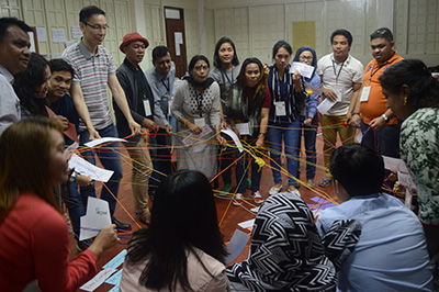 MPI Participants holding web of yarn